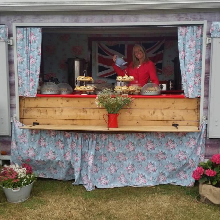 Girl serving tea behind counter